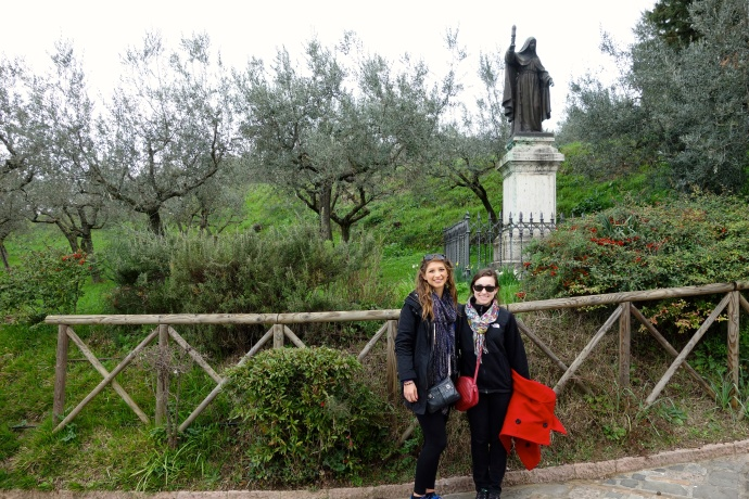 In front of Saint Clare statue at San Damiano